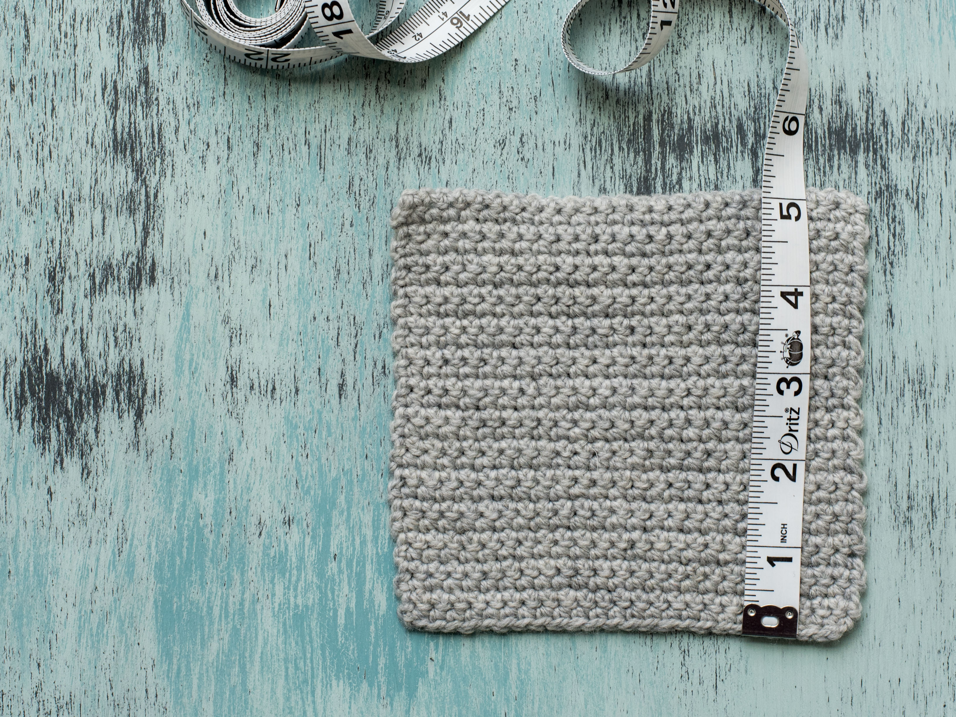 Measuring Rows on Gray Crochet Swatch