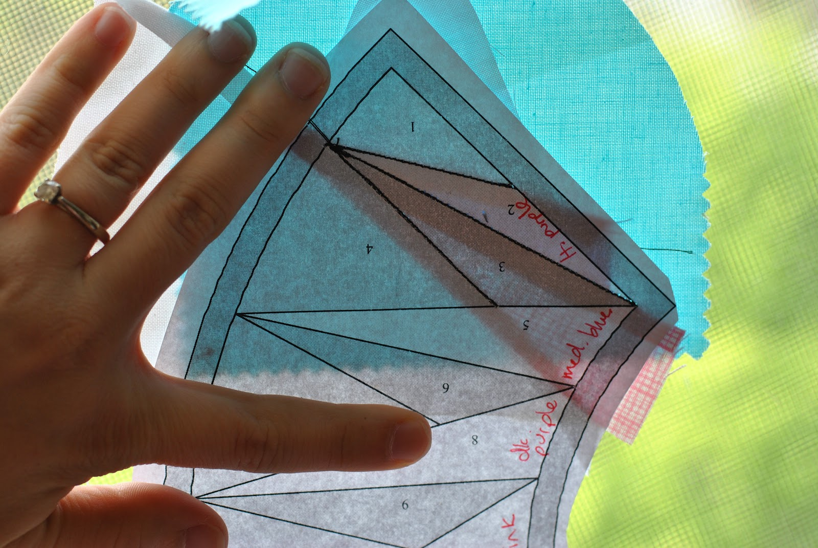 Holding paper piecing up to the light