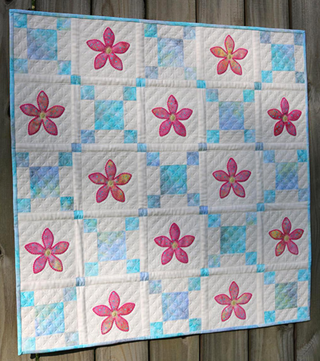 AccuQuilt dies make piecing and machine embroidery applique easy.