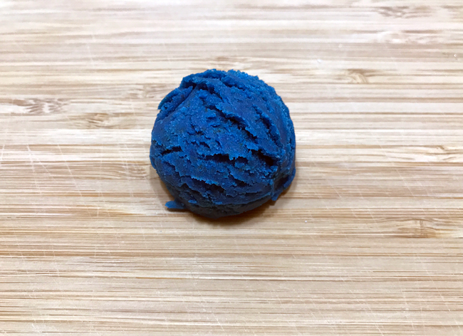 Scoop of blue cake pop dough
