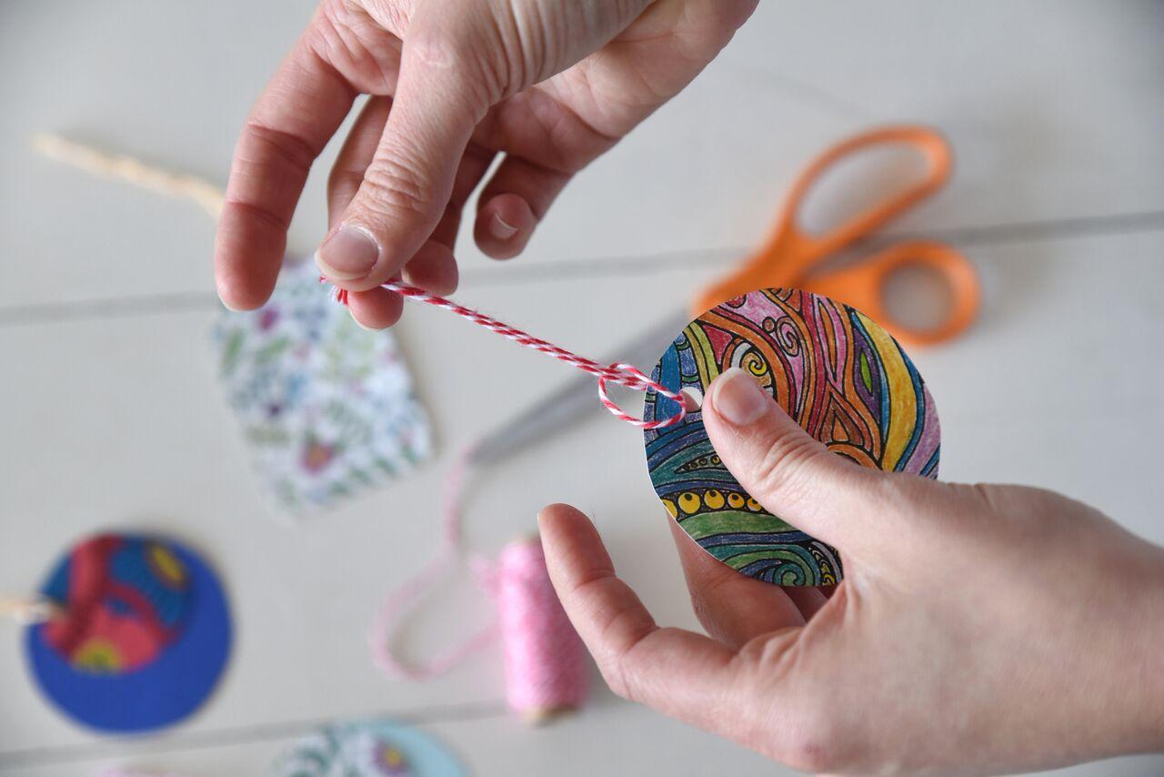 adding ties to homemade gift tag