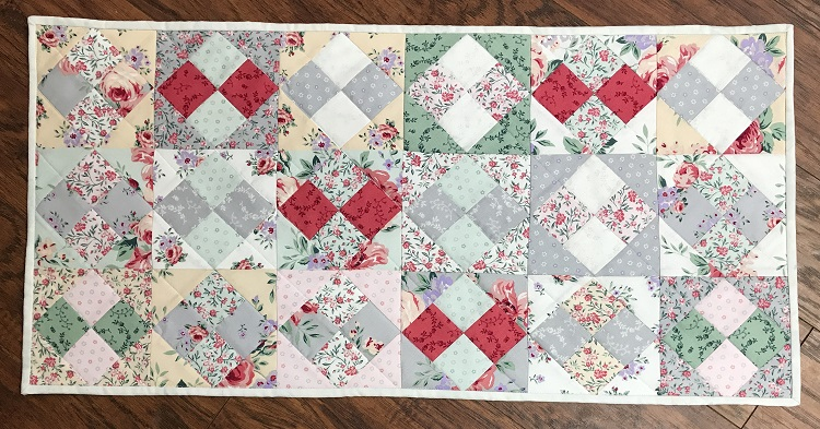 finished charm square table runner