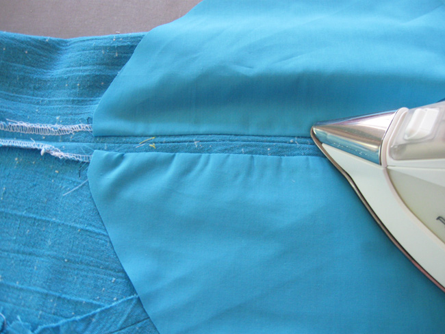 press pocket bag seams