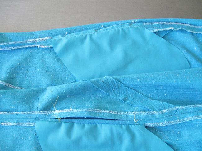 Stitch pocket pieces on side seam