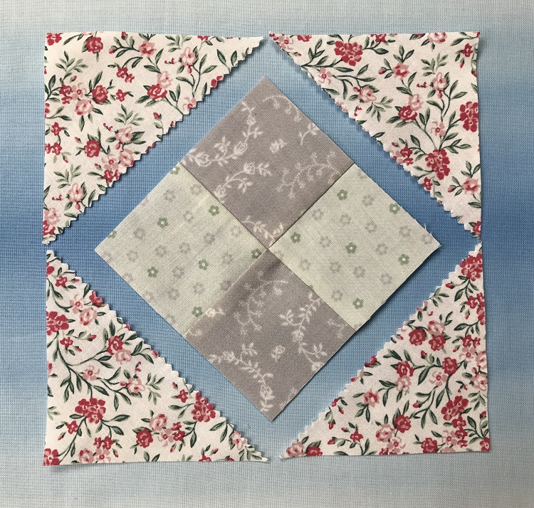 adding triangles to the charm squares