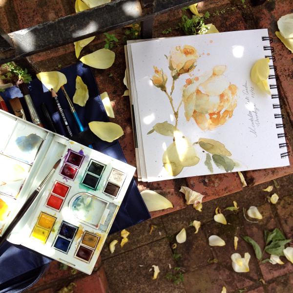 Travel watercolor kit in nature