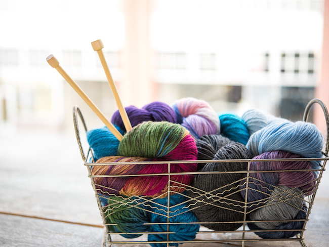 Cloudborn Yarn and Knitting Needles in Wire Basket