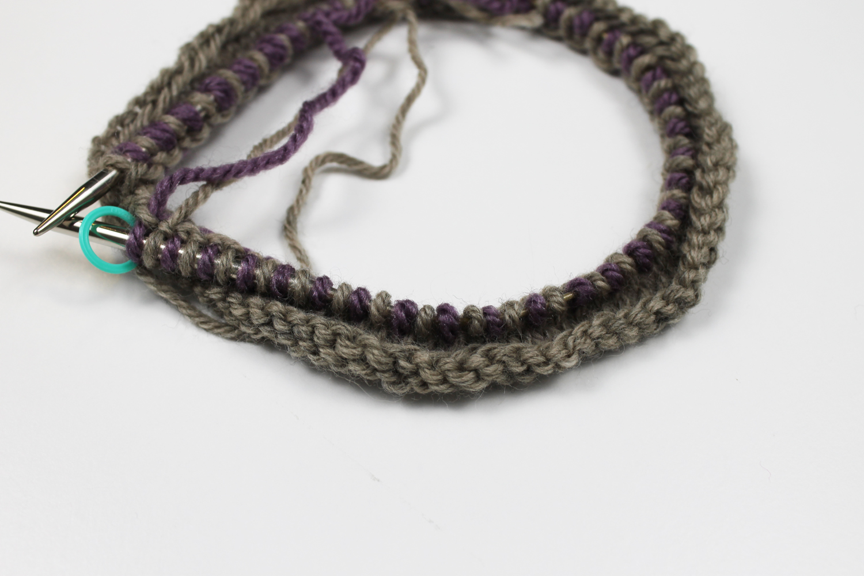 Knitting a Latvian braid close up on needles