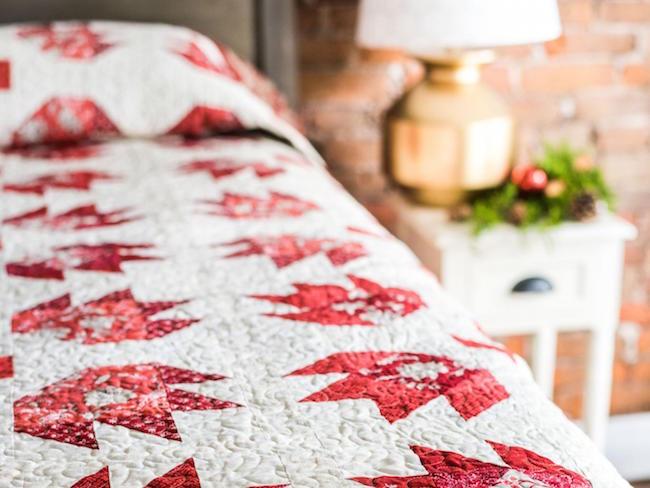 Crimson Rose Quilt Kit on Bed