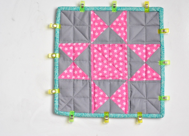 Quilt binding held down with clips