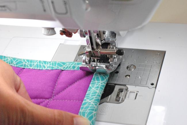 sewing corner of quilt binding