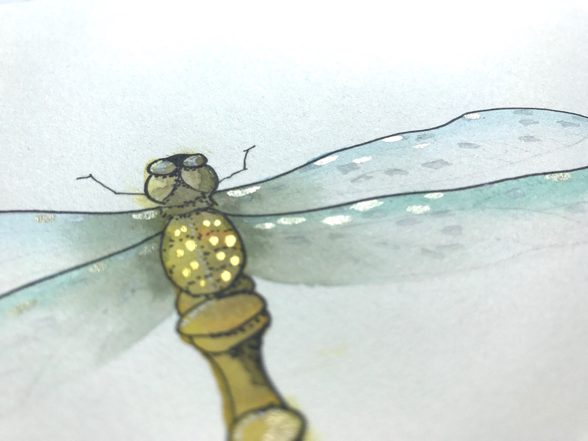 adding white gel pen to dragonfly