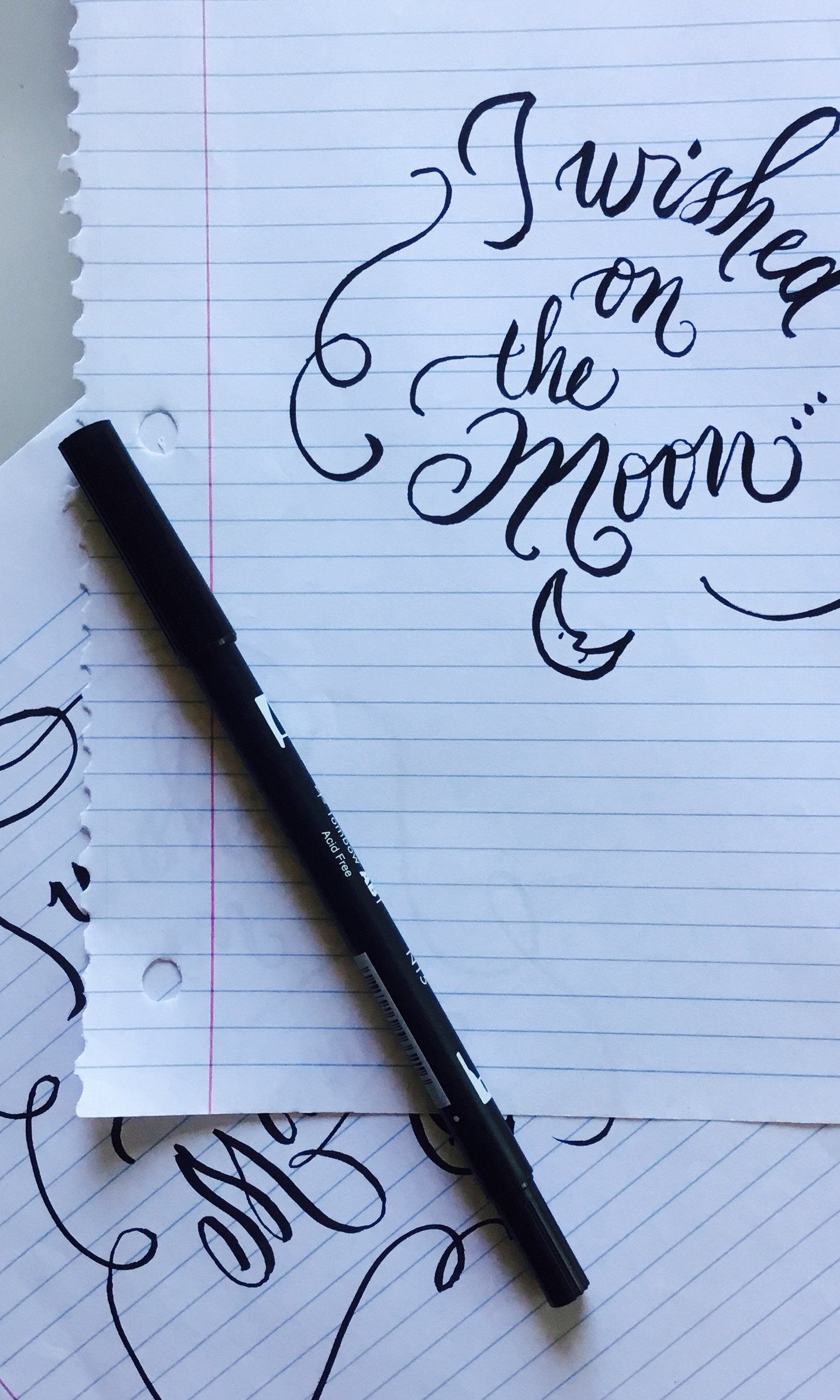 Brush calligraphy on notebook paper