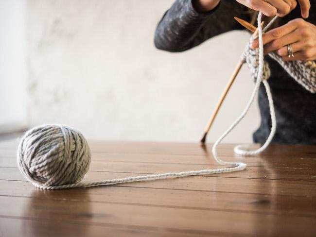 Knitting with gray yarn