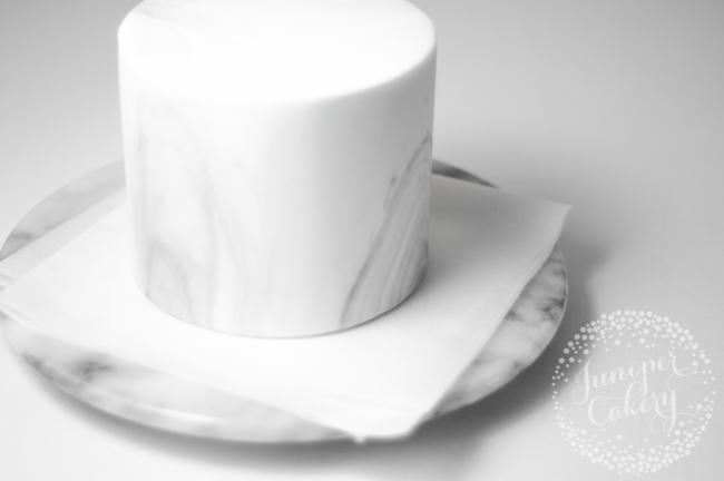 Adding ribbon to a cake