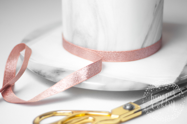 Learn how to add ribbon borders to cakes