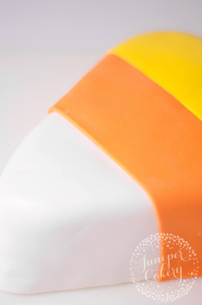 Discover how to make a cool candy corn themed cake