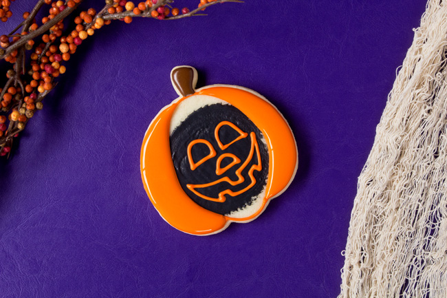 cute jack-o-lantern cookies made with royal icing