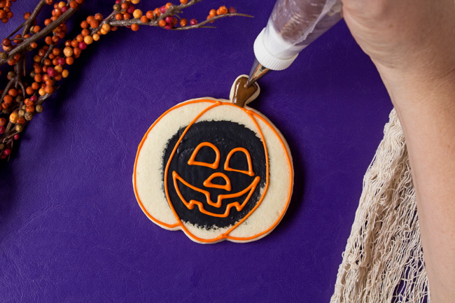 easy jack-o-lantern cookies with royal icing