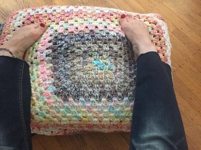 feet on crochet pouf