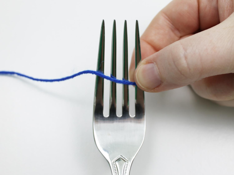 Making a pom pom with a fork