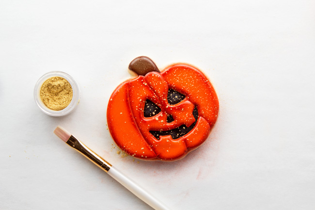 simple jack-o-lantern cookies made with royal icing