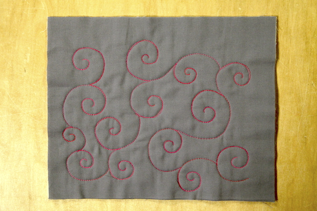 Swirls Quilted on Gray Fabric