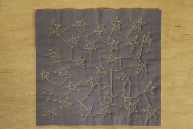 Quilted Stars on Gray Fabric