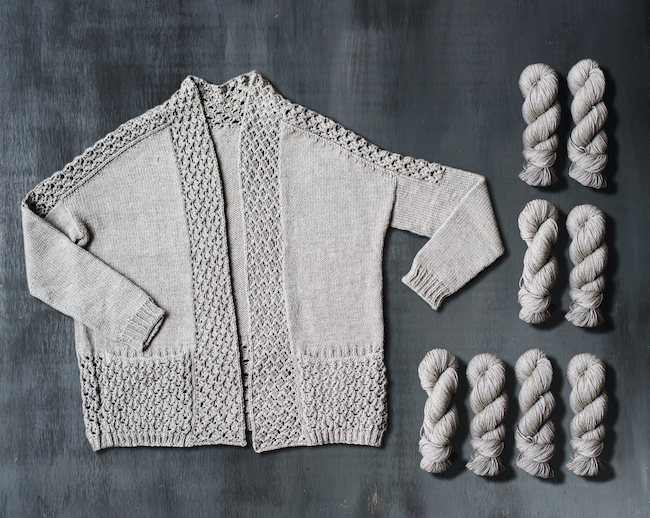 Knit Tealeaf Sweater With Skeins of Gray Yarn