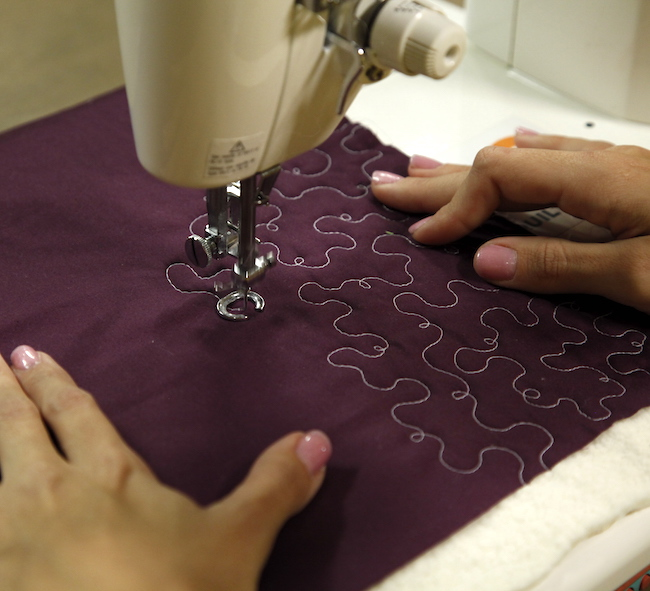 Stipple Quilting on Purple Fabric