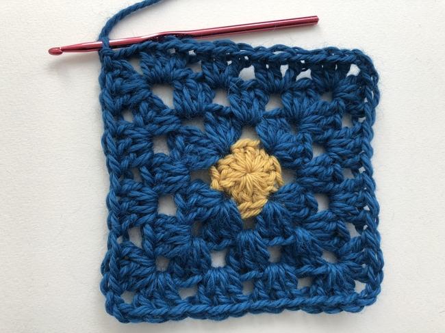 small circle inside crochet granny square