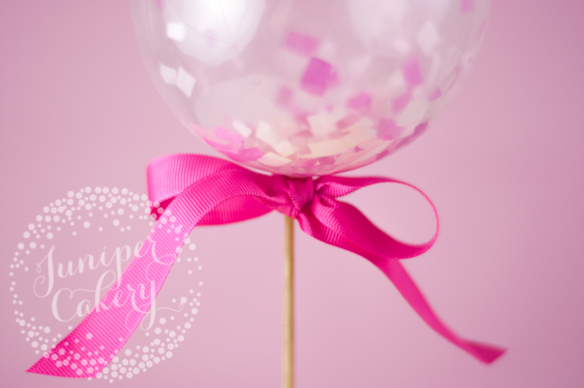 DIY mini balloon cake topper and pink ribbon
