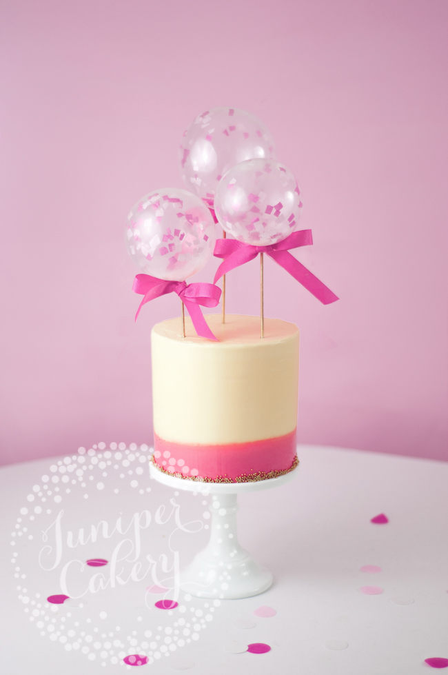 DIY mini balloon cake toppers in fondant covered cake