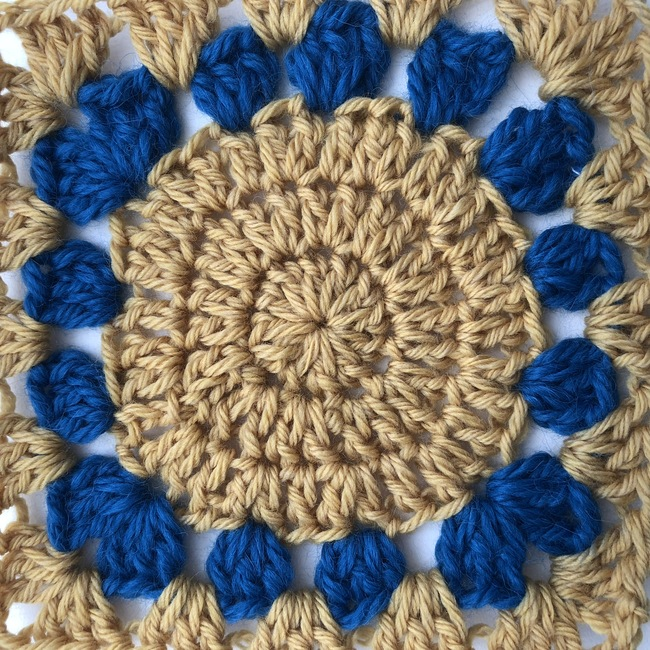 five round crochet granny square witch circle in center