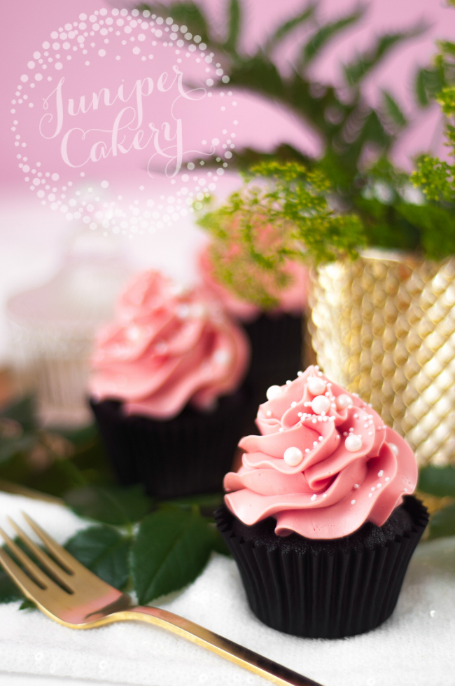 Stylish black velvet cupcake with pink frosting