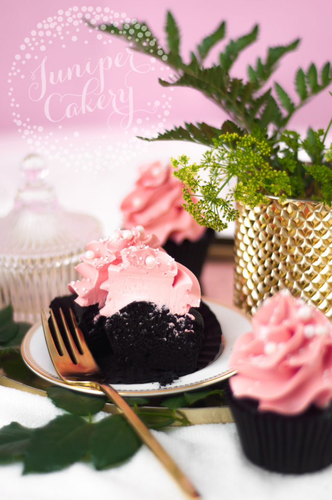 Chic black velvet cupcake with pink frosting