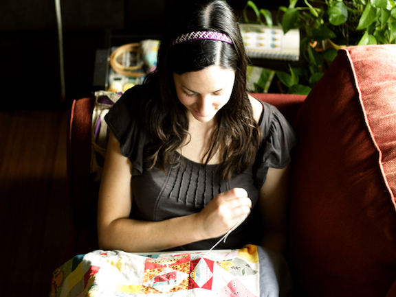 Girl Relaxing While Hand Sewing