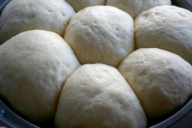 Risen rolls in cake pan
