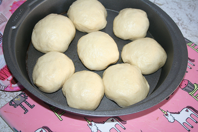 Rolls divided into portions in cake pan