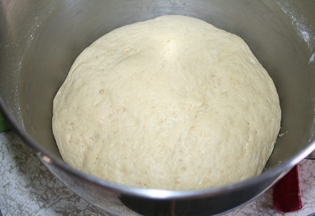 Milk bread dough rising in bowl