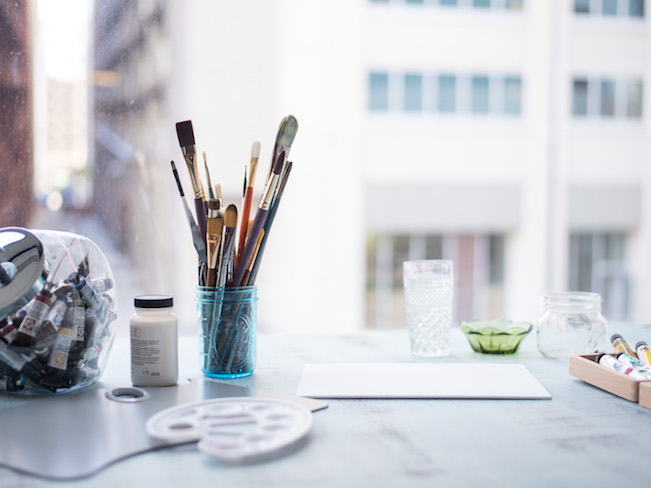 Painting Workspace with Brushes, Palette, and Paints