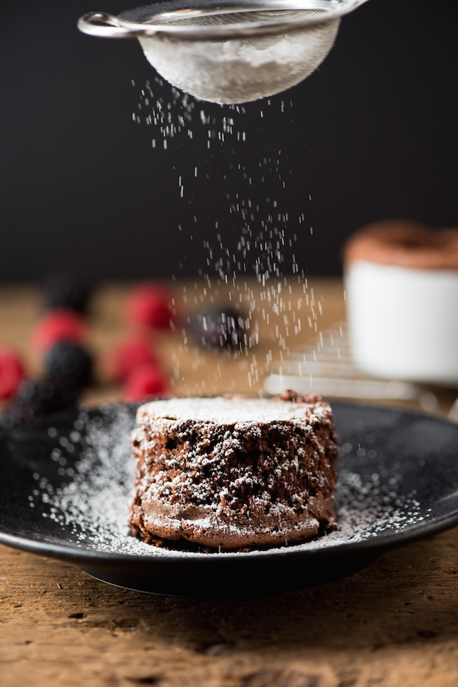 Dusting Powdered Sugar on Small Chocolate Cake