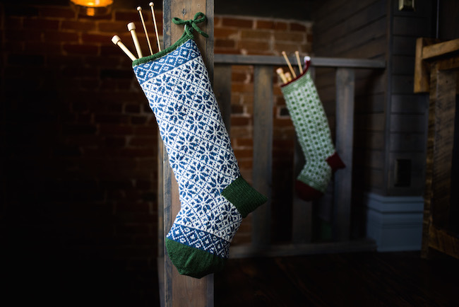 Colorful Christmas Stockings Filled With Knitting Needles