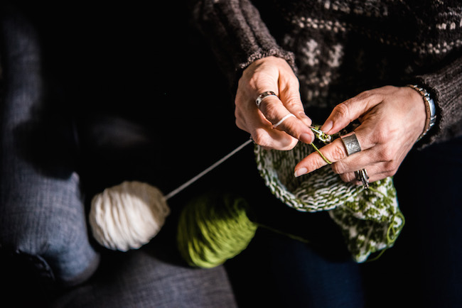 Knitting with green and white yarn