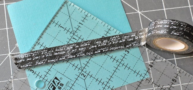 Marking a line on a quilting ruler with tape