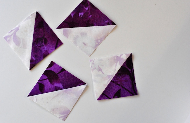 Half-Square Triangles Made WIth Purple and White Fabric