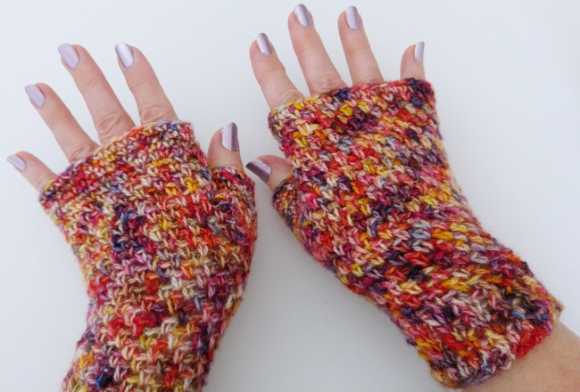 crochet fingerless mitts made with variegated yarn