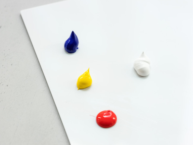 Dots of Primary Color and White Acrylic Paint