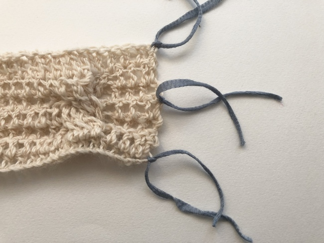 crochet cozy with ribbons