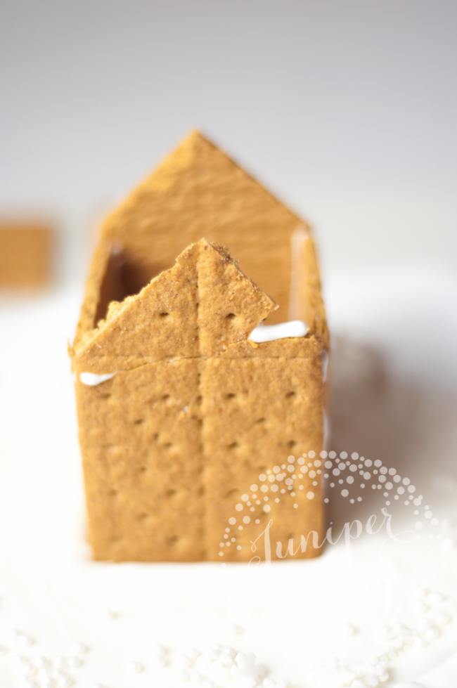 Make a cute gingerbread house using graham crackers